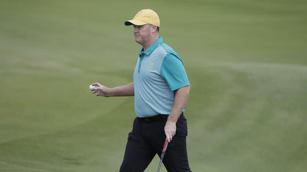 Marcus Fraser of Australia chips to the 16th hole during the first round of golf at the Olympics. Fraser shot a 63 to take a three-stroke lead. Thursday's play marked the return of golf to the games after a 112-year absence.