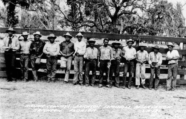 Seminole cowboys hold individual branding irons, Brighton Indian Reservation, 1941.