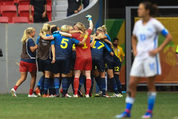 The Swedish soccer team celebrates after beating the U.S. in the quarterfinals match on Friday.