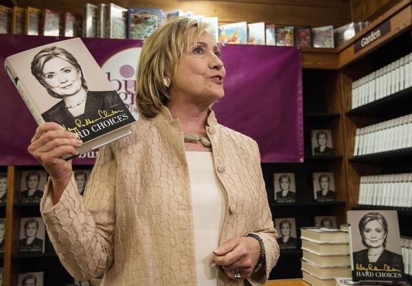 "Hillary Clinton arrives to sign her book ""Hards Choices"" at a bookstore on Martha's Vineyard on August 13, 2014. According to the Clintons' 2015 tax returns, the couple earned $3.1 million from book advances and royalties."