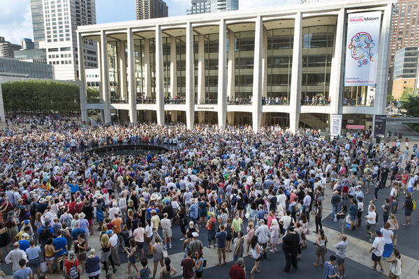 "The ""public domain"" chorus gathers at Josie Robertson Plaza at Lincoln Center on Saturday in New York, NY."