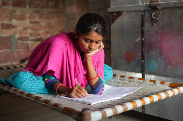 Durga studies for final exams in her second year of college.