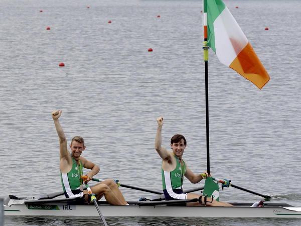 Gary O'Donovan and Paul O'Donovan, of Ireland, celebrate their silver in the men's rowing lightweight double sculls during the 2016 Summer Olympics in Rio on Friday.