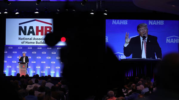 Republican presidential nominee Donald Trump is captured by a TV camera during an address to the National Association of Home Builders in Miami Beach, Fla., on Aug. 11.
