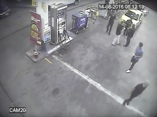 In this surveillance video frame released by Brazilian police, swimmers from the U.S. Olympic team appear with Ryan Lochte (right) at a gas station last weekend. A top Brazil police official said the swimmers damaged property at the gas station.