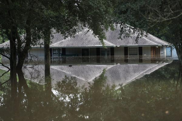 A flooded home is seen on Aug. 15, 2016 in Baton Rouge, Louisiana. Record-breaking rains pelted Louisiana over the weekend leaving the city with historic levels of flooding that have caused at least seven deaths and damaged thousands of homes.  (Joe Raedle/Getty Images)