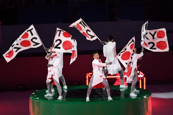 Dancers wave flags ushering in excitement for the 2020 Summer Olympics, which will be held in Tokyo.