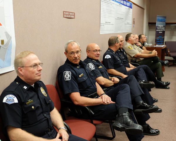 Pasco Police Department officers support their chief as the U.S. Department of Justice releases its new report at a press conference Monday.