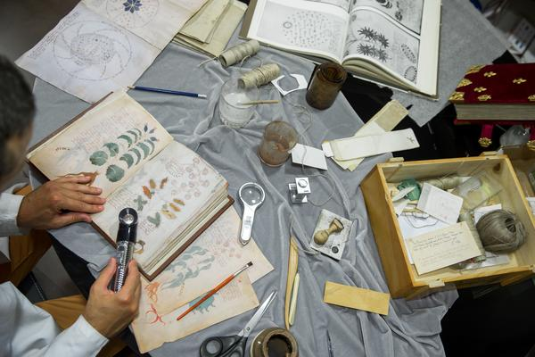 Luis Miguel, a quality control operator with Siloe, works on cloning the illustrated,hand-written Voynich Manuscript in Burgos, Spain, on Aug. 9.