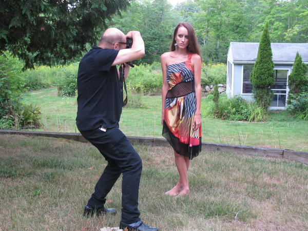Fabric designer, Harry Umen, photographs Hailey Boczar modelling a dress.