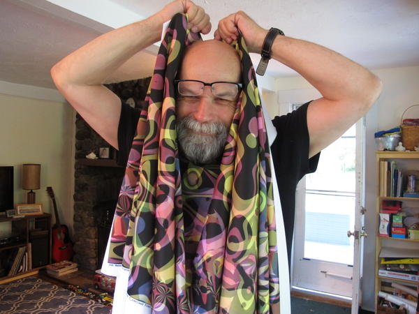 Umen poses with a neoprene fabric he designed.