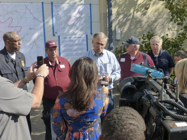 Washington Gov. Jay Inslee addresses the media after meeting with fire managers near Spokane.