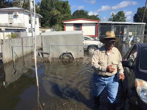 In Lafayette, George Alexander checks on an elderly neighbor's property for the first time since the evacuation. A resident here since 1959, Alexander isn't sure when – or if – he'll be able to move back to his own home due to the extensive damage.