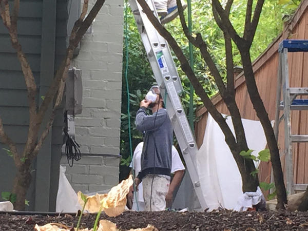 <p>A crew with Bridgetown Painting gets ready to paint the side of an older home in Southeast Portland.</p>