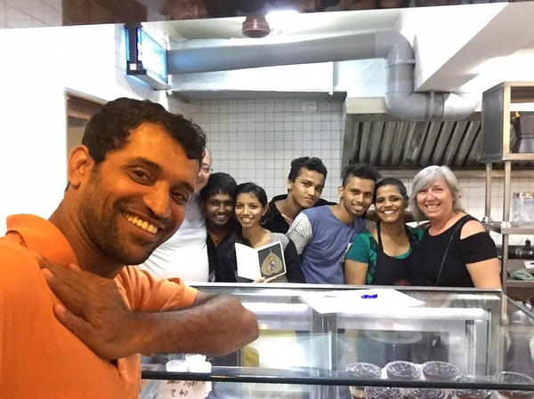 Amin Sheikh, the owner of Bombay to Barcelona Library Cafe along with his employees.
