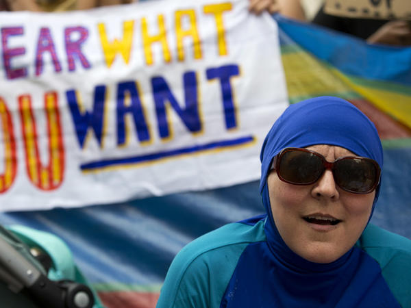 """Burkini bans in France have sparked international outrage. In London, people recently held a """"Wear what you want beach party"""" outside France's embassy."""