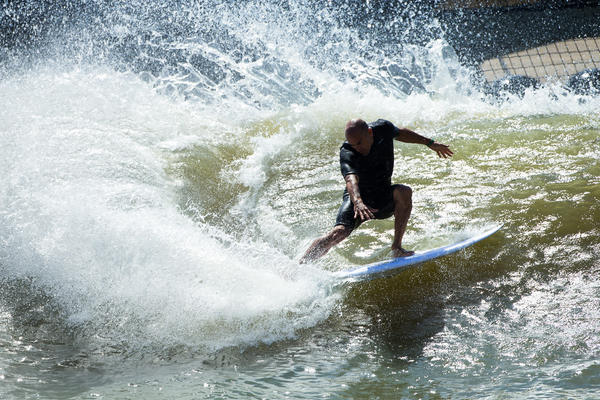 Surfers say the artificial wave at Kelly Slater Wave Co.'s pond has a natural feel. But the technology that creates it requires a several-minutes-long wait between swells.