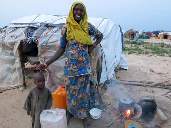Kaltume Abubakar, displaced by Boko Haram fighting, cooks the evening meal for her family of four — son, daughter, husband and mother-in-law, outside her makeshift home at the informal Muna camp, near Maiduguri, northeastern Nigeria.