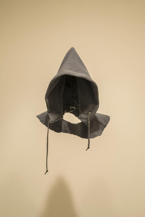 David Hammons made his 1993/2016 work <em>In the Hood </em>out of a found sweatshirt and fishing wire.