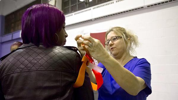 Registered nurse Danielle Vetter demonstrates use of a tourniquet.