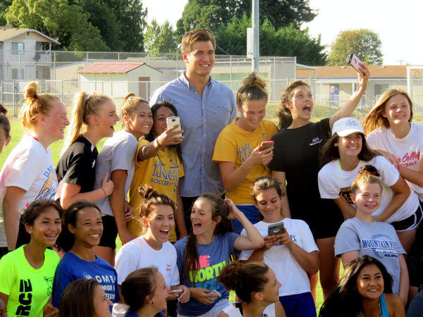Gold medalist Nathan Adrian poses with the Bremerton High School soccer team Monday before a community celebration of his Olympic feats.