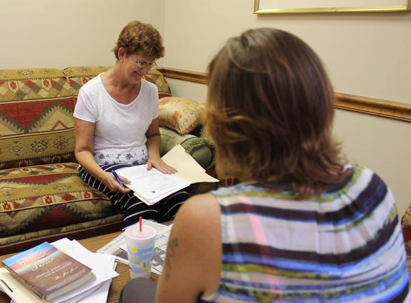 Peer support sepcialist Sally Moore (left) gives a needs assessment to Deana Kilpatrick at PEEPs in Recovery in Reeds Spring, Missouri.