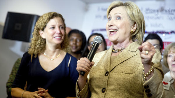 Democratic presidential candidate Hillary Clinton, right, speaks to workers at a campaign office for Rep. Debbie Wasserman Schultz, D-Fla., earlier this month.