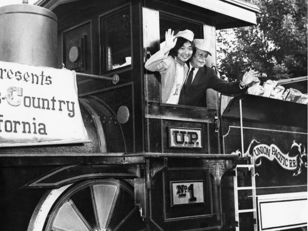 Seiji Ozawa and Arthur Fielder, aboard a train during Tanglewood on Parade, 1975.