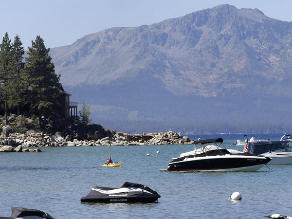 A kayaker paddles along Zephyr Cove, near the site of the 20th Annual Lake Tahoe Summit in south Lake Tahoe, Nev. President Obama said the environmental challenges of conservation and fighting climate change are inseparably linked.