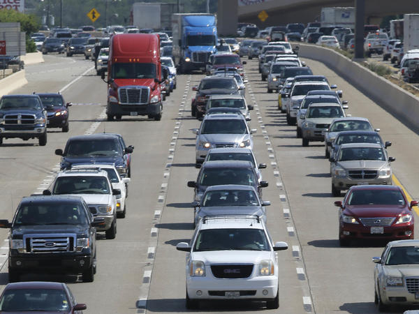 Drivers work their way out of Dallas during rush hour on July 1. The U.S. is on track to break the annual record for gas consumption this year.