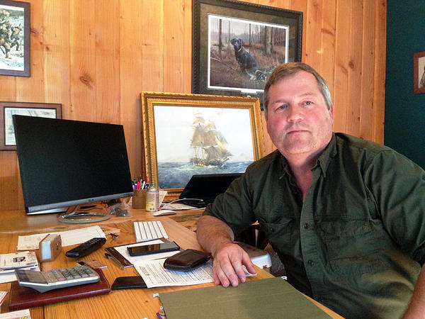 House Republican Floor Leader J.T. Wilcox, in his home office in rural Pierce County, says campaigns require shoe leather and money. But he says lobbyists who host fundraisers for him don't get more access than anyone else.