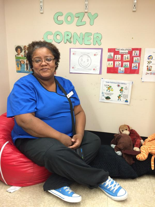 Terrie Walker, known to her preschoolers as Miss Terrie, sits in her Bridgeport classroom's Cozy Corner. The space is meant to help the children manage their own big feelings.