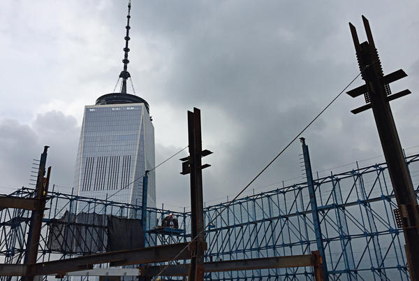 Three World Trade Center is under construction near One World Trade Center, which was completed in 2013. The new building stands 1,079-feet tall, and its topping-out ceremony was held in June in New York City.