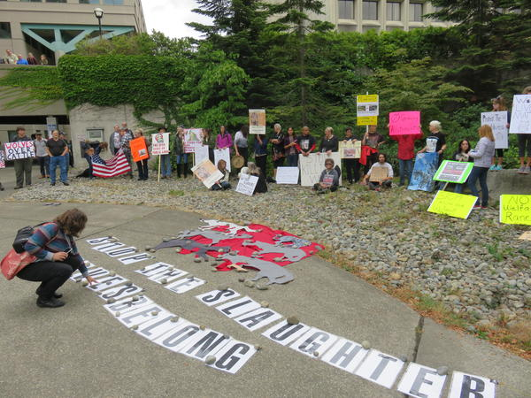 Protesters decried the in-progress killing of the Profanity Peak wolf pack in Olympia Thursday.