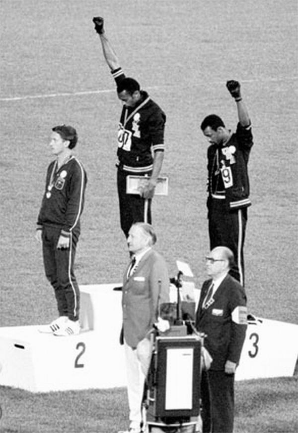 Tommie Smith (center) and John Carlos performed a Black Power salute at the 1968 Summer Olympics in Mexico City.