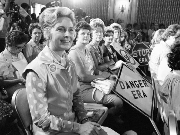 Women opposed to the Equal Rights Amendment sit with Phyllis Schlafly (left), national chairman of Stop ERA, at a hearing of the Republican platform subcommittee on human rights and responsibilities in 1976.