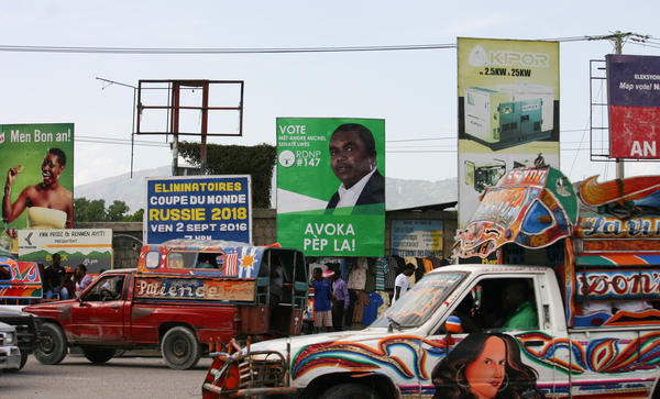 Billboards advertise the scheduled October election in Haiti, which has been without an elected government since February.