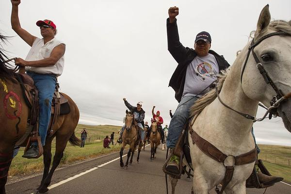 "Protesters ride near the site of construction. The company building the pipeline says in court documents that it ""is not destroying and has not destroyed any evidence or important historical sites."""