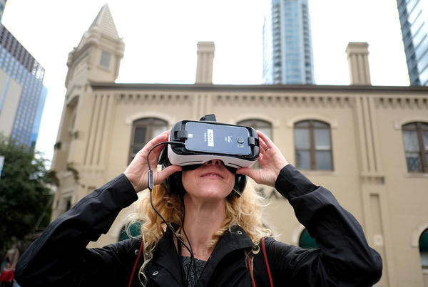 Laura Skelding looks through Samsung Virtual Reality headset during the SXSW interactive festival in downtown Austin on March 11, 2016.