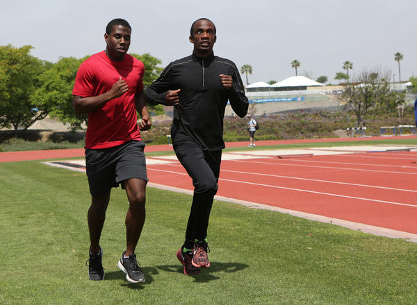 Wesley Williams and Lex Gillette go on a warmup run. For the past nine years, Williams has been Gillette's helper.