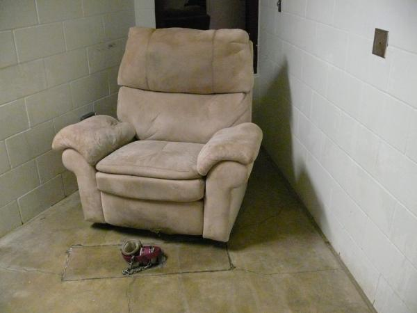 The Camp 5 TV room includes a comfortable chair, with padded leg restraints, where a compliant detainee could watch multiple channels and DVDs.