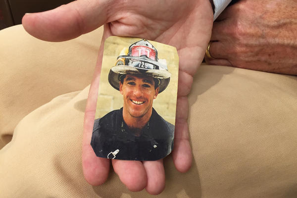 Michael Burke keeps in his wallet a photo of his brother, FDNY Captain William Burke Jr., who was one of the first responders killed at the World Trade Center.