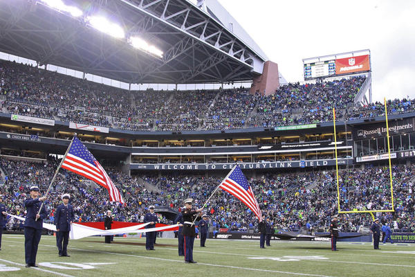 File photo of flag presentation before Seattle Seahawks game in 2014.
