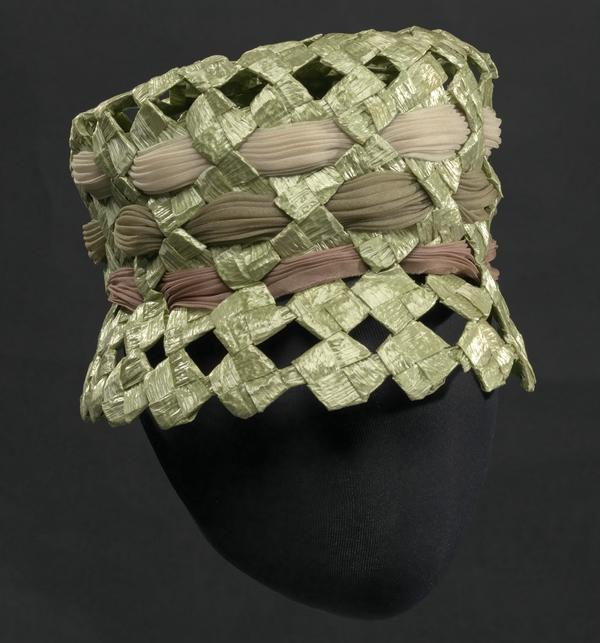Mae Reeves designed this green raffia lamp shade hat with silk and polyester.