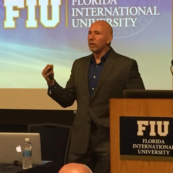 FIU sociology professor and pollster Guillermo Grenier describes the new Cuba Poll on Wednesday.