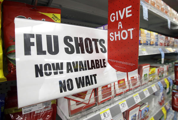 """The start of flu season is still weeks or months away, but you can get a flu shot now at many pharmacies. """"It's a way to get people into the story to buy other things, says Tom Charland, an analyst who tracks the walk-in clinic industry."""