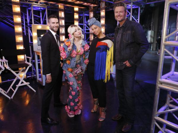(l-r) Adam Levine, Miley Cyrus, Alicia Keys and Blake Shelton on <em>The Voice</em>.
