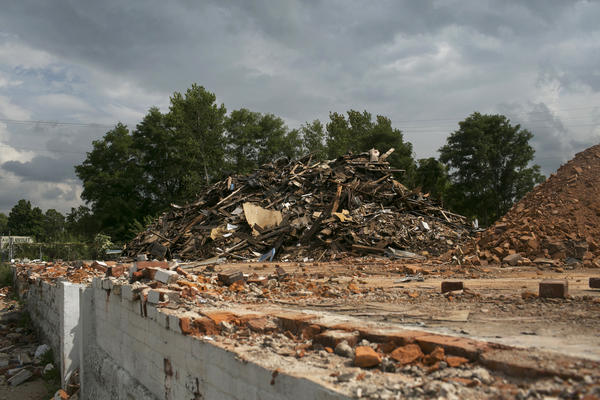 Rubble from where a factory once stood in Springfield. As the city transitions away from manufacturing, it relies more on low-paying service jobs like those at call centers and nursing homes.