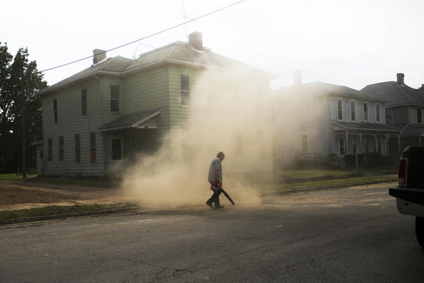 Tony Smith cleans an empty lot where a house once stood in Springfield. The city's population has fallen from more than 80,000 in the 1970s to less than 60,000 today.