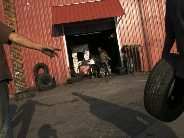 "People work at Jim's Tire City on Selma Road in Springfield, Ohio. ""Springfield is a rather typical small city that has grown poorer over the years,"" former mayor Roger Baker says."
